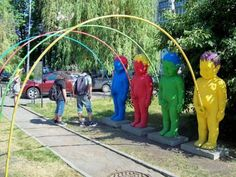 Multicolored Peeing Sculptures in the Park In This Picture: Photo of peeing sculptures