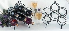 """J Wire Six Bottle Wine Rack by J Wire. $23.99. Dimensions are 11""""l x 5""""w x 13""""h. Made in the USA. Durable wrought iron construction. Holds six bottles of wine. Highest quality black powder-coat finish. The free-standing six bottle wine rack is made of heavy iron construction. to prevent scratching of surfaces, rubber tabs are fastened to the bottom of the legs. moving the holder and wine is convenient with a handle at the top. the sturdy iron is cured under heat to p..."""