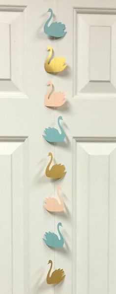 Swan Garland Streamer for Wedding Decoration, Baby Shower, Birthday Parties, Baby Nursery, Home Decoration, Photo Backdrop Enhance any occasion with this beautiful Swan Garland. Sewn with metallic gold thread adds a touch of elegance. Theres one looped ribbon end for hanging. Color Palette: Peach, Mint, Metallic Gold Measurement: 7 ft (86 inches) Quantity: 1 strand This item can be made in any color. For custom orders, feel free to contact me. Thank you