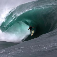 Taking a spill on a big day at Teahupoo in Tahiti.