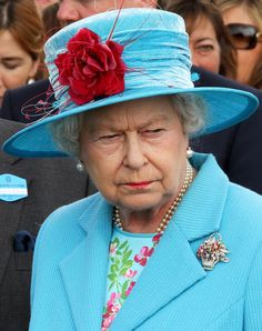 Floral Basket Brooch worn by HM Queen Elizabeth II - love her in aqua . . . but oh what a scowl.