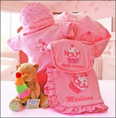 """Custom embroidery of the baby's name on this ruffled lined baby blanket in this adorable cupcake layette set wrapped in an authentic doghnut box.  The adorable teddy bear is wrapped on top to show off the sweetest gift at the baby shower.  http://www.ExtraSpecialBaskets.com Click on SHOP, Gift Baskets & Flowers.  Category, """"Variety of Gift Baskets,"""" """"Infants & Toddlers."""""""