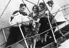 World War 2: Survivors from the bombed ship SS Athenia being helped to safety by a soldier. The Athenia was torpedoed and sunk by a German U-Boat a few hours after the start of World War II.