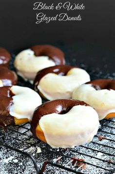 Black & White Glazed Donuts! These are baked donuts, inspired by the ever-so-delicious black and white cookies. Donuts that are half chocolate and half vanilla topped with chocolate glaze and vanilla glaze. | from willcookforsmiles.com