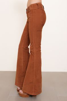 """Low rise corduroy bell bottoms. belt loops. Back pockets. Front button and zipper fly closures. Style #: OB464667 Material: Cotton/Spandex Color:""""Copper Oxide"""" Model is wearing a size 24"""