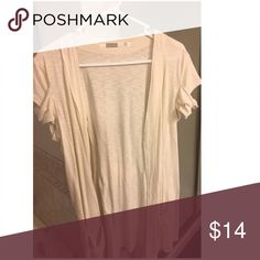 🤸♀️Athleta Cardigan Gently Worn. Great details on sleeve and behind. (Sleeve is same as behind gathering) see picture. Cream color. Great for before or after a workout.                                                    ✨Top Rated Seller✨ 💨 Fast Shipping 💨 💕 Quick Responses 💕  ✅ Great Items ✅ 🛍Awesome Bundle Deals 🛍 😁 Thanks for loo Athleta Sweaters Cardigans