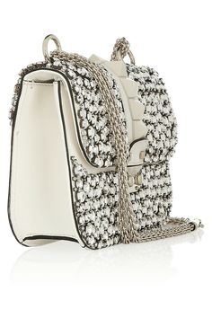 White shoulder handbag with rhinestone decorations and silver chain
