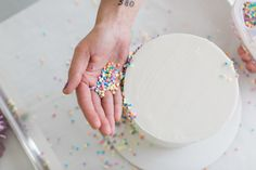 Learn how to make a metallic sequin cake in glittering gold. A step-by-step tutorial for this sparkling gold cake, created by Jenna Rae Cakes for TheCakeBlog.com.