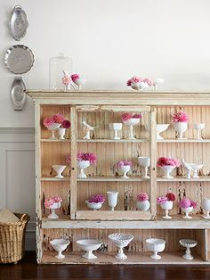 Show off your collection—like these beautiful milk glass containers—in a general-store display case.