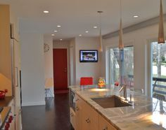 Lighting design done by Kara Manning at Lightology  Apollo Pendant by Access Lighting
