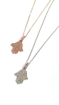 Finchley Road Necklace - The timeless elegance of the Hamsa Hand has reached new, glittering heights with the new Lydia of London Hamsa necklace. Silver or Rose Gold Plated Swarovski Crystal options.  Long chain 22cm in length. #hamsa #crystal #swarovski #handoffatama #hamsanecklace