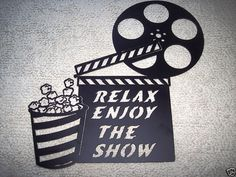 Home Theater Decor Large Clapboard and Popcorn Relax Enjoy the Show 2FT Movie Metal Wall Art. $39.99, via Etsy.