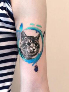 Cat tattoo on the left bicep.