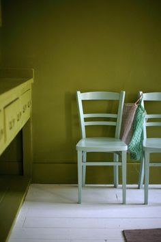 Citrine green from Little Greene for the walls and traditional Victorian dresser in what was the house's original kitchen / junk chairs painted in Farrow & Ball's Pale Powder eggshell.