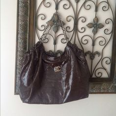 Brown XL Chain Strap Fashion Bag Brown XL Chain Strap Fashion Bag.... Trade Value Higher,there's is normal wear and ,another listing with inside pics Bags