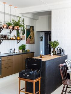Gravity Home: Black White And Brown Kitchen in a Vintage Apartment in Norway