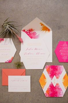 Geometric pink and orange watercolour wedding invitation | Jessica Lauren Photography via 100 Layer Cake