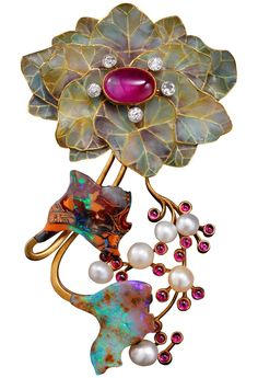 """PHILIPPE WOLFERS (1858-1929). """"Feuilles et Fruits"""" brooch in the shape of flowers and leaves. Yellow gold, Burmese ruby, diamonds, pearls, and opal. Brussels, - c1900"""