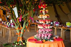 This picture has it all.  Bright and Colourful flowers, cakes, ribbons and table settings