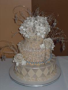A winter themed elegant Mad Hatter wedding cake that I designed recently!