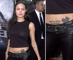 """Angelina Jolie got a dragon tattoo on her abdomen during a drunk night in Amsterdam, and later covered it up with a large black cross. She also has ab ink of the Latin words """"quod me nutrit me destruit,"""" which means, """"what nourishes me, destroys me."""""""