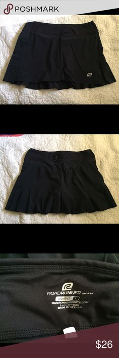 Road Runner Running Skirt Black excellent used condition, no pilling or markings, washed to brands standards Road Runner Skirts