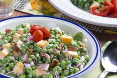 Our Easy Peasy Pea Salad is simple and has never been more delicious! Fresh peas with, crispy bacon, cheddar cheese, and a creamy sauce makes these the best!