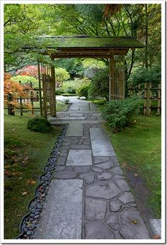 southwest of house past east view.....I like the varied stones in the walkway and the arbor! Japanese garden (Portland), path idea  Front entry patio & path to side yard.