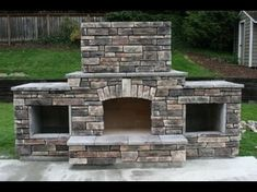 Outdoor Stacked Stone Fireplace with Hearth and Seating Wall Outdoor Wood Burning Fireplace, Outdoor Fireplace Patio, Outdoor Stone Fireplaces, Outside Fireplace, Outdoor Fireplace Designs, Diy Fireplace, Fire Pit Backyard, Backyard Patio, Fireplace Seating