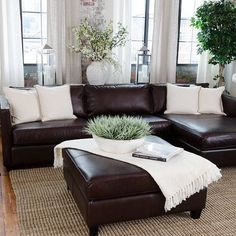 Love The Vase And Lanterns Behind Couch Brown Leather