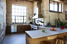 The reclaimed wood kitchen in the Clark home. The home was designed by Lake Flato architects.