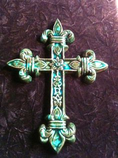 Fleur de Lis Cross handmade green and blue green decorative Pottery Wall Hanging. $40.00, via Etsy.
