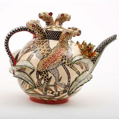 Leopard teapot is cool. It would have been so easy just to paint leopards on it but instead the potter put the 3D raised heads and necks.  Love it!
