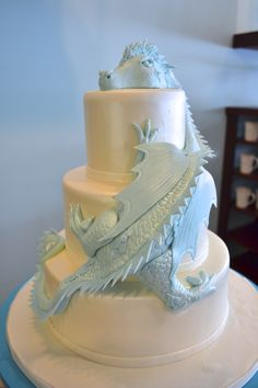 Love This Exquisite Teal Dragon Fondant Wedding Cake by Sugarland! Amazing! Then e can wear her dragon on her wrist also