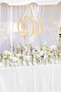 Beautiful bud vase escort cards | A Romantic Riverfront Blush Wedding