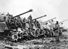 American M4A2 Sherman tank crews do a final prayer before going into battle against the Germans. Germany, 1945
