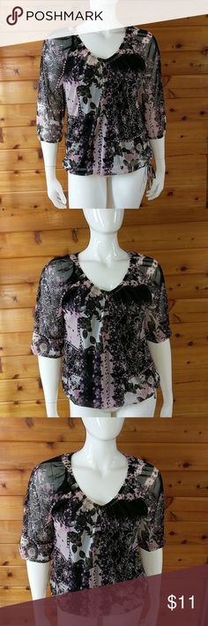 Romantic chiffon pullover top with built in tank Shear, romantic Floral, black and lavender v-neck pullover top. Black built in spaghetti strap stretch tank underneath. Tags removed Size large/ extra large Mannequin is 41 - 32 - 41 This is a comfortable fit on her, but could go up an inch or two easily. Excellent used condition. Tops Blouses
