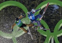 France's Ted Piccard (L) and Daron Rahlves of the U.S. collide during their ski cross freestyle skiing