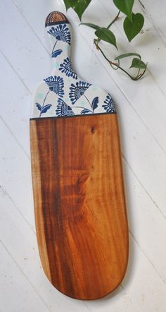 This beautiful serving board is lovingly handcrafted by Millie from reclaimed Black Wattle timber.It is handpainted and sealed to protect the painted surface.Whether you use it to serve cheese,dips,antipastos, fruit,breakfast or even dinner, this beautiful Black Wattle timber board will present your favorite foods with a unique style and organic simplicity.| The original| Entirely handcrafted handpainted by Millie Fairhall| One of a kind | Strong.Durable.Versat...