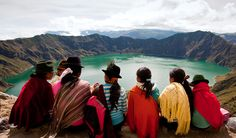 Quilotoa Crater Lake, Ecuador Girls wearing traditional hats and scarves gather at Quilotoa Crater Lake in Ecuador.