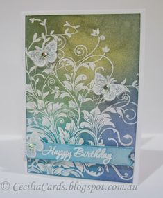 "By Cecilia Hsieh. Stamp ""Leafy Vines"" (Hero Arts) in VersaMark on white cardstock; heat emboss with white powder. Sponge Distress inks all over the panel. Buff to remove ink from the embossed areas. Spritz with Perfect Pearls mist."