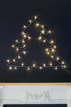 Fairy lights have so many uses, you can even create an alternative Christmas tree by tracing the outline of a tree and fixing it to a wall. It creates the perfect statement piece for your seasonal décor and a great focal point. Diy Craft Projects, Crafts For Kids, Fairy Lights In Trees, Christmas Trees, Xmas, Traditional Christmas Tree, Light Up Letters, Alternative Christmas Tree, Tree Lighting