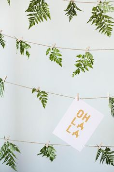 DIY: Create a fern backdrop for your next party, to hang cards or for photos. Simply hang up rows of string horizontally, line each string with clothespins, and clip each fern.