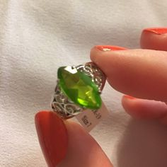 Genuine Sterling Silver Green Sapphire Ring. Beautiful sparkling green sapphire with sterling silver band. Size 7.  Gorgeous! Jewelry Rings