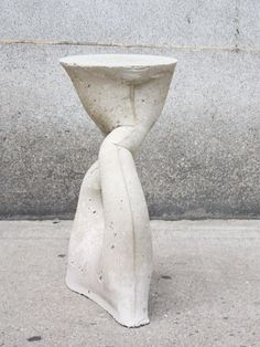 Custom one of a kind Kreten Side Table by Souda / The Kreten Side tables are fiber-glass reinforced concrete. The tables also function as garden stools. Each piece is cast into a spandex mold, so each one is one of a kind. / #cement #concrete #tables #stools