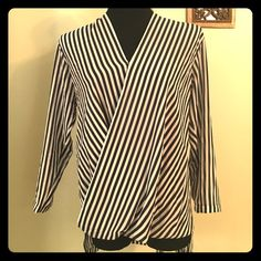 """NWT MICHAEL KORS NAVY STRIPE SURPLICE BLOUSE SML  Beautiful blouse by Michael Michael Kors. Extremely beautiful deep navy blue stripes on Ivory, light and flowing material- best worn with a Cami. Style number MH44KD017K. New with tag, bracelet sleeves ,surplice blouse- sway open style front w/clip (of course) longer in back for added style! That alone makes this top very versatile! Measures across at ; bust down.. 20"""" ( the tucks & sways make this flattering!! Matte jersey material-100%…"""