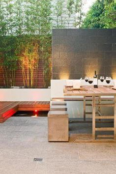 Backyard Outdoor Dining Table With Cup Of Whine Bamboo Garden And Also The Romantic Lighting Enjoy Breeze Beautiful Modern Patio Design http://seekayem.com