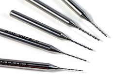 Our new Tungsten Carbide Micro Drills now come in sizes as small as 0.1mm, 0.2mm, 0.3mm.....for delicate drilling through all hard metals.   http://www.eternaltools.com/carbide-micro-drills/#