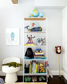 """Yes, trucks and cars can be styled to be objects on a shelf. Do it! The shelf is timeless, the chair is great for all kids' spaces, but all the accessories bring in the child's personality,"" Emily says. ""Show restraint with the furniture, but go nuts with the accessories by styling it all playful. ""The lucite box full of vintage toy planes is just that: a lucite box with vintage planes in it. I got them for $40 at an antique store and I wanted to put them under a glass dome, but you can't ...."