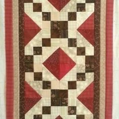 1404753310-table-runner-with-borders-attached---copy.jpgAccuquilt